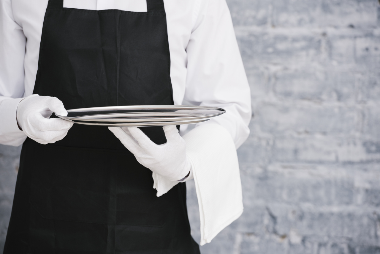 Close up of a waiter in uniform